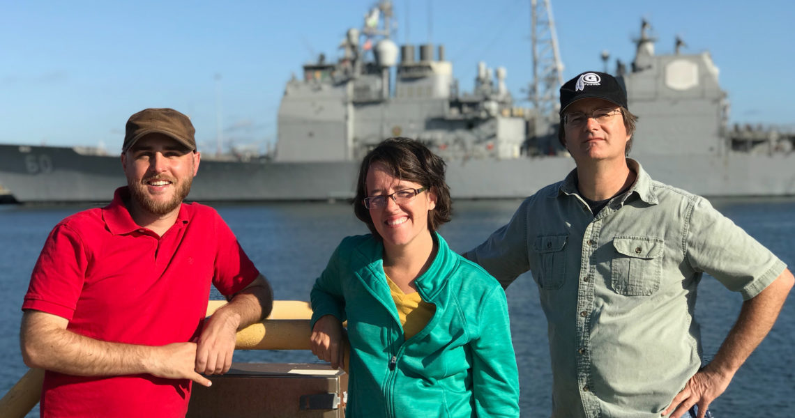 crew shot in front of battleship