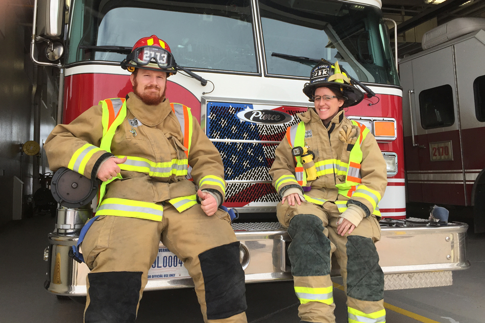 pair of firefighters with their truck