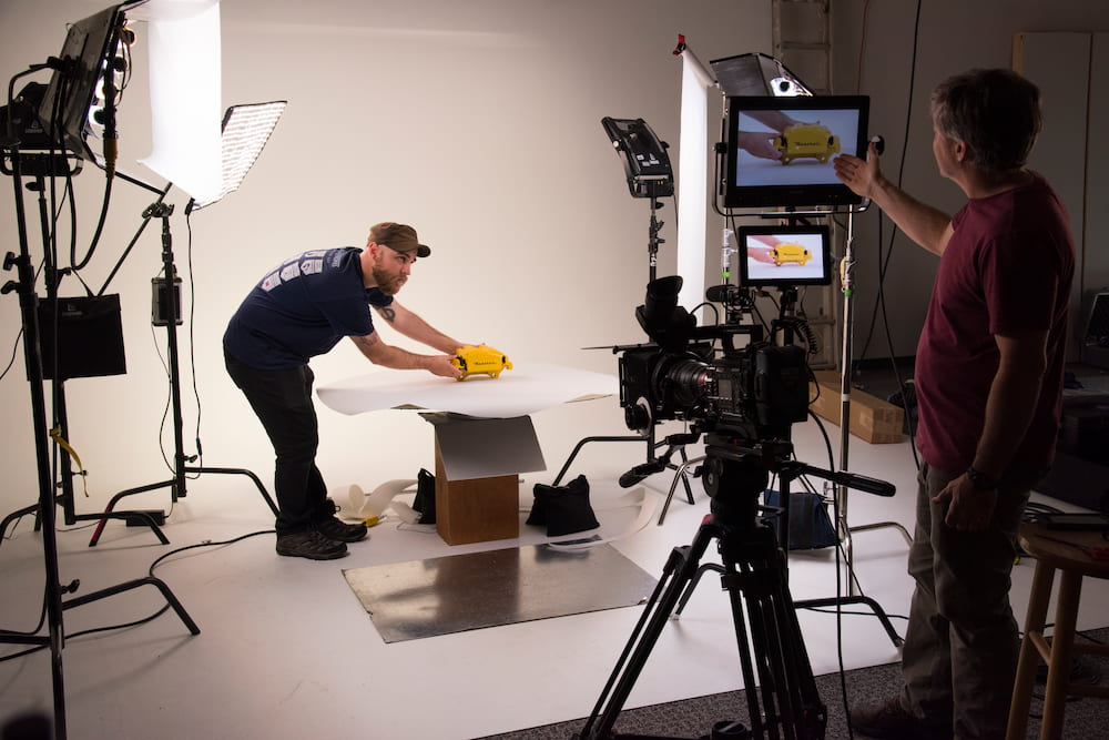 two video production team members working on a promotional video