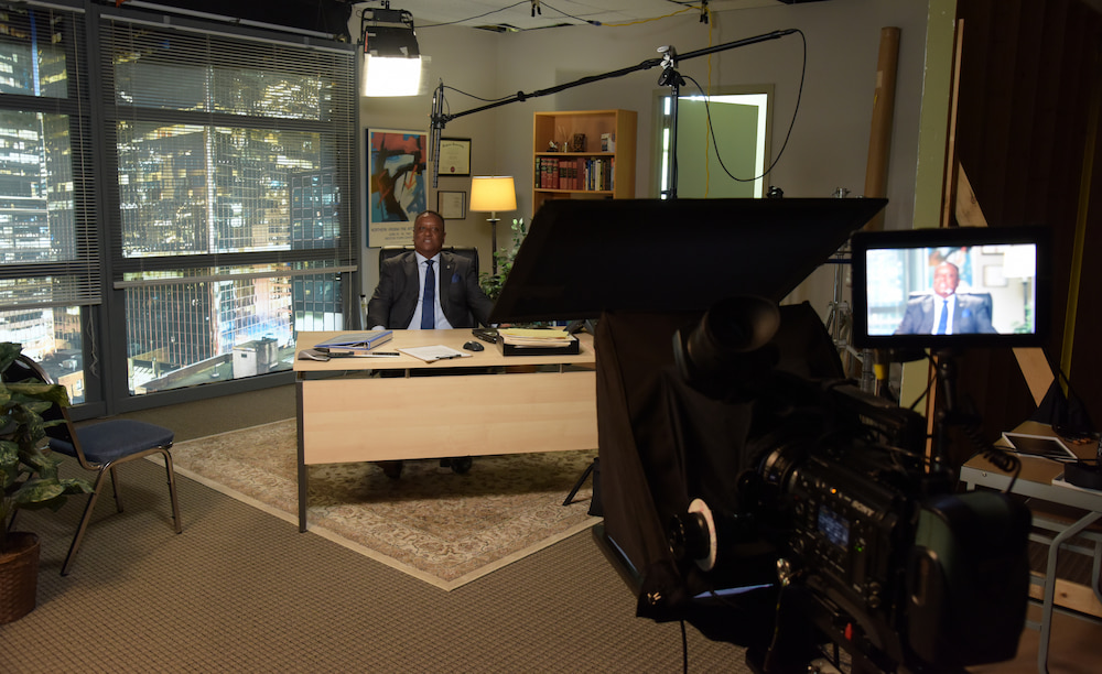 video production of a man sitting at a desk